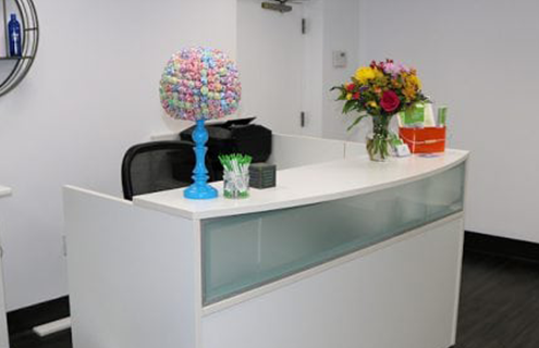 The inside receptionist area of the Rockville lice clinic.